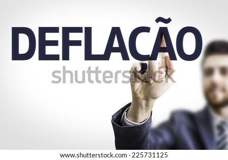 Business man pointing to transparent board with text: Deflation (In Portuguese) - stock photo