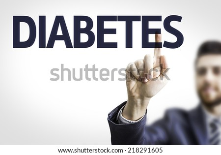 Business man pointing to transparent board with text: Diabetes - stock photo