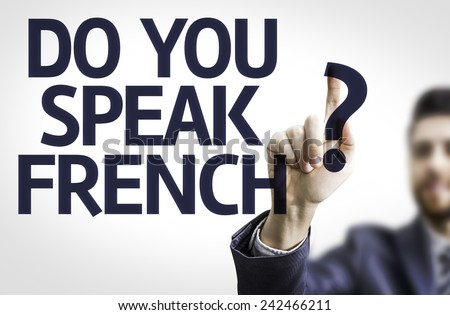 Business man pointing to transparent board with text: Do You Speak French? - stock photo
