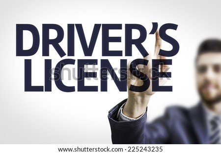 Business man pointing to transparent board with text: Drivers License - stock photo