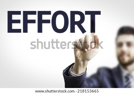 Business man pointing to transparent board with text: Effort - stock photo