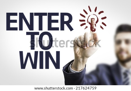 Business man pointing to transparent board with text: Enter to Win - stock photo