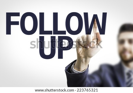 Business man pointing to transparent board with text: Follow Up - stock photo
