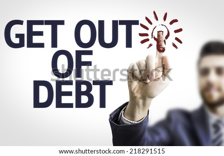 Business man pointing to transparent board with text: Get Out of Debt - stock photo