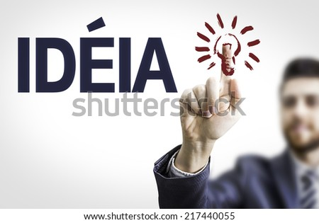 Business man pointing to transparent board with text: Idea (In Portuguese)