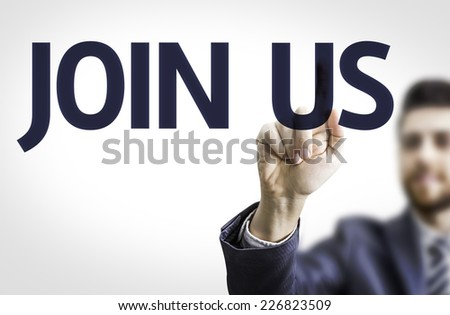 Business man pointing to transparent board with text: Join Us - stock photo