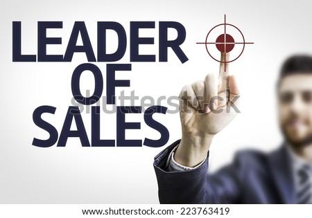 Business man pointing to transparent board with text: Leader of Sales - stock photo