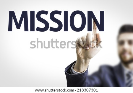 Business man pointing to transparent board with text: Mission - stock photo
