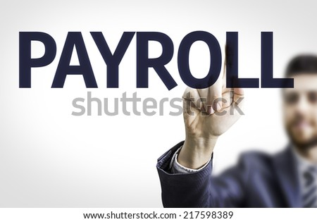 Business man pointing to transparent board with text: Payroll - stock photo
