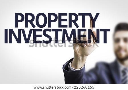 Business man pointing to transparent board with text: Property Investment  - stock photo