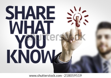Business man pointing to transparent board with text: Share What You Know - stock photo