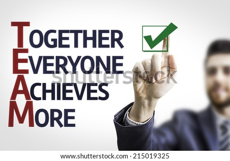 Business man pointing to transparent board with text: Together Everyone Achieves More  - stock photo
