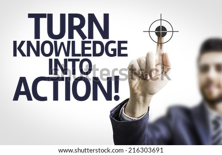 Business man pointing to transparent board with text: Turn Knowledge Into Action! - stock photo