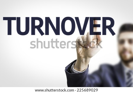 Business man pointing to transparent board with text: Turnover - stock photo