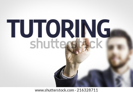Business man pointing to transparent board with text: Tutoring - stock photo
