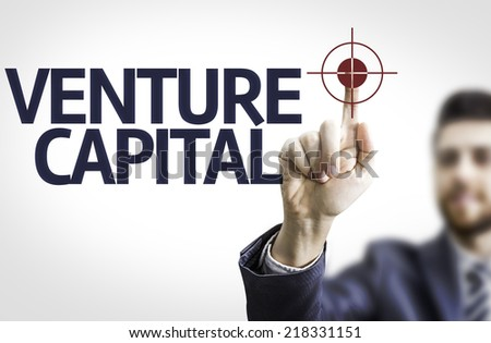 Business man pointing to transparent board with text: Venture Capital - stock photo