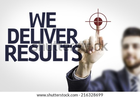 Business man pointing to transparent board with text: We Deliver Results! - stock photo