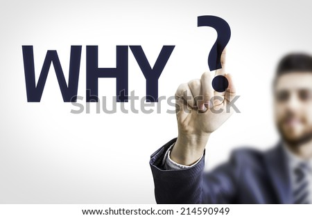 Business man pointing to transparent board with text: Why? - stock photo