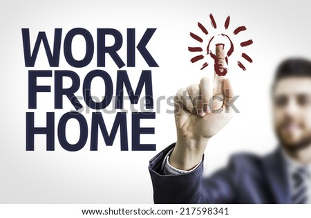 Business man pointing to transparent board with text: Work From Home