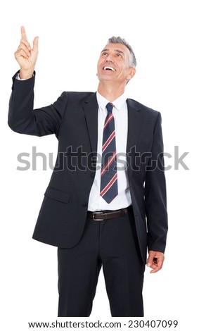 Business Man pointing upwards. - stock photo
