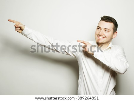 business man points with fingers in the right side - stock photo