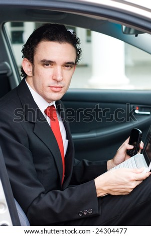 business man portrait inside a car