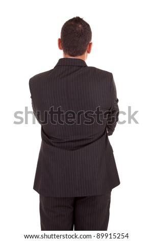 Business man posing backwards, isolated over white - stock photo