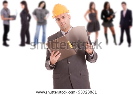 Business man posing with some people in background - stock photo