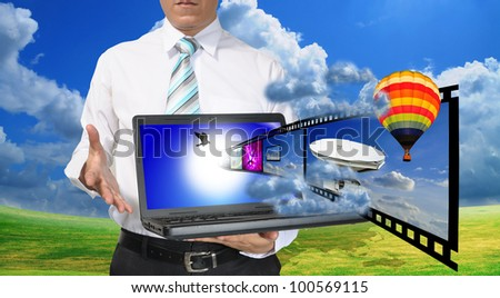 Business Man present laptop with streaming video or filmstrip - stock photo