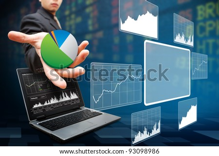 Business man present the report graph and light - stock photo