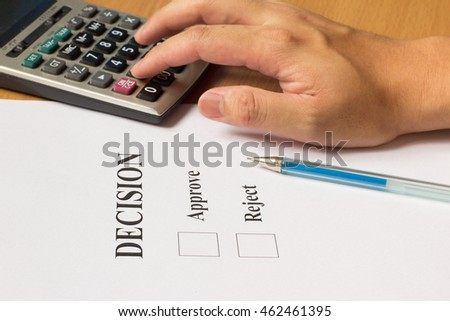 Business man press calculator for make the approve or reject decision