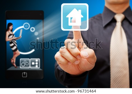 business man press on house icon from mobile - stock photo
