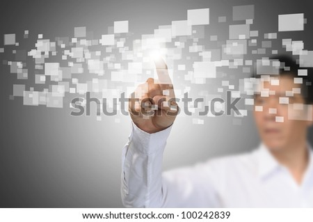Business Man press or touch the touch screen interface - stock photo