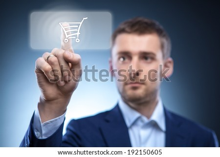 business man press touch button with shopping cart - stock photo