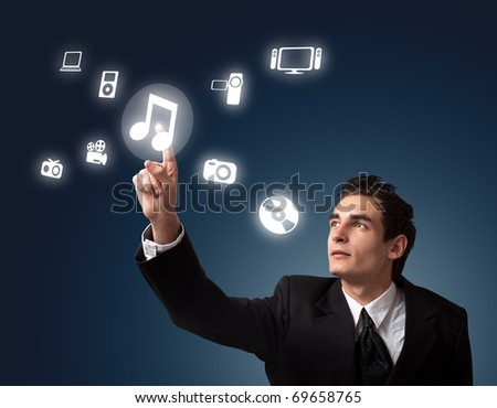 business man pressing a MUSIC button