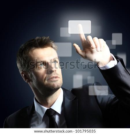 business man pressing a virtual button - stock photo