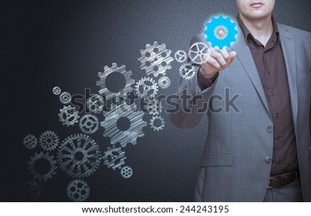 Business man pressing buttons - stock photo