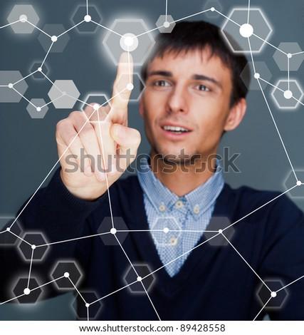 Business Man pressing digital button, futuristic technology - stock photo