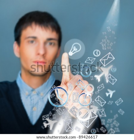 Business Man pressing digital button while managing his life needs, futuristic technology - stock photo