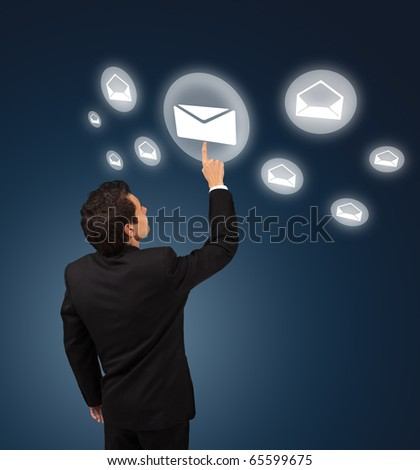 business man pressing e-mail button - stock photo