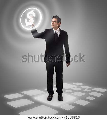 business man pressing MONEY button, futuristic digital technology - stock photo