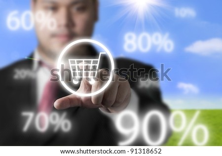 Business man pressing shopping cart button