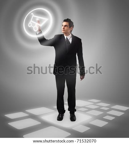 Business man pressing  shopping cart button, futuristic digital technology - stock photo