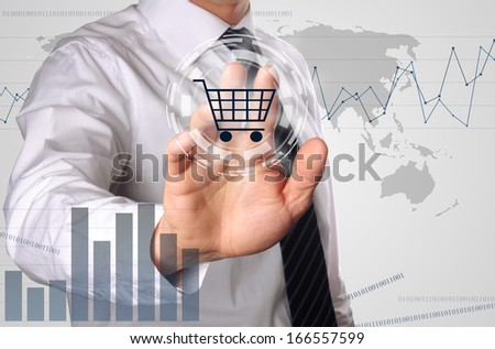 business man pressing shopping cart icon, concept for growing online shopping - stock photo