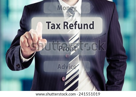 Business man pressing Tax Refund button at his office. Tax refund concept, toned photo. - stock photo
