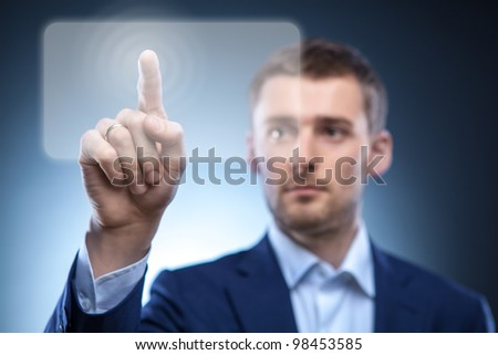 business man pressing touchscreen button - stock photo
