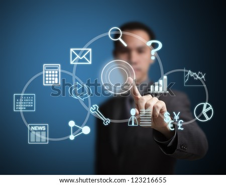 business man pressing virtual application button on touchscreen - stock photo