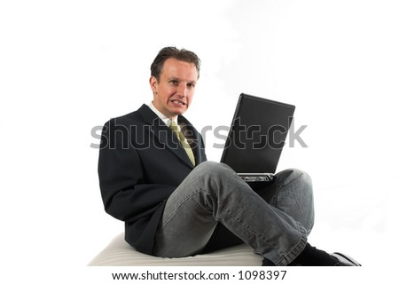 Business man pulling a face, afraid for the news - stock photo