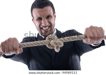 Business man pulling and bond tied with rope  concept  isolated on white background in studio - stock photo