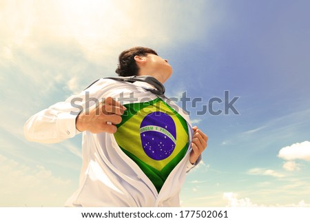 Business man pulling his t-shirt open, showing Brazil national flag, retro color tune - stock photo